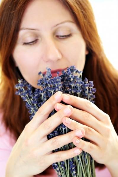 264685-woman-smelling-lavender